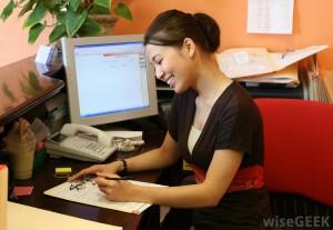 woman-as-desk-doing-paperwork